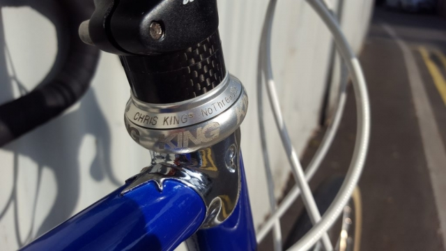 Blue Colnago Tecnos with Chris King head set